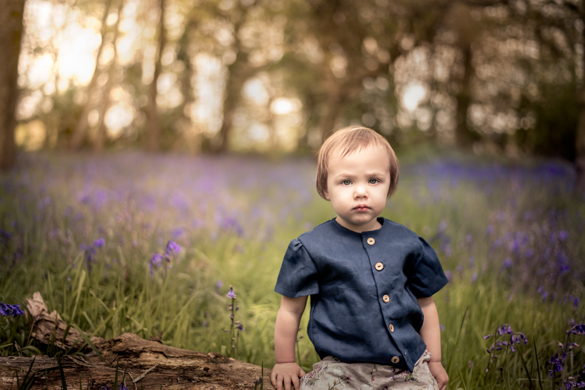 girl in bluebell garden photo