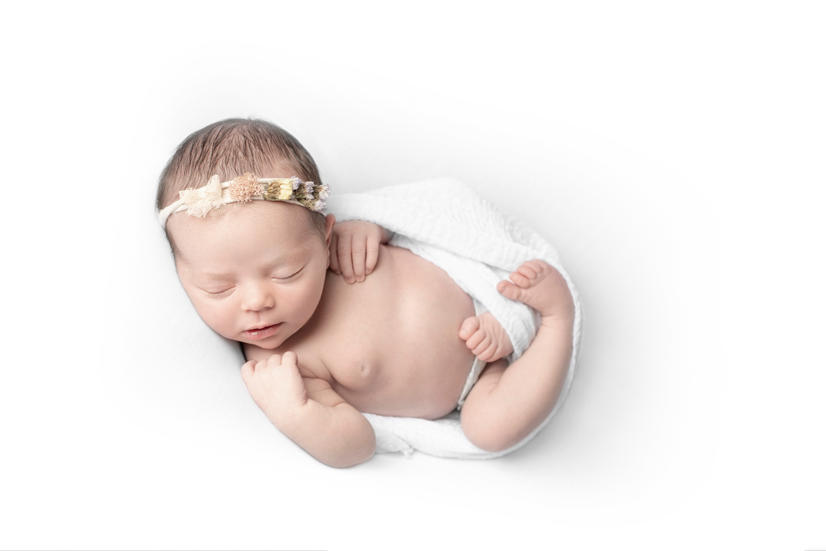 newborn photo in white