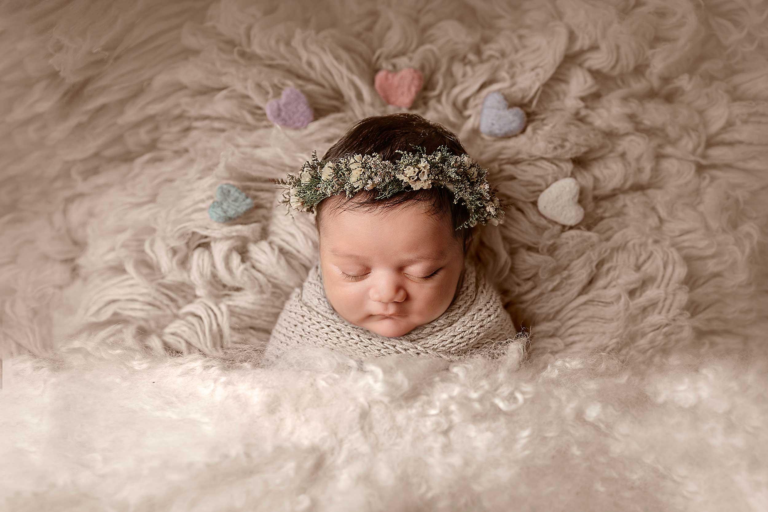 beautiful baby in fluffy blanket